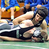 Midview Matt Seres pins EC Nick Saxton in 113 wt. class at Elyria Catholic Dec. 14.  Steve Manheim
