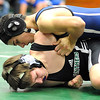Midview Alex Szuch , top, defeats EC Carmen Carasello in 138 wt. class Dec. 14.  Steve Manheim