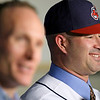 Cleveland Indians manager Manny Acta, right, smiles as he listens to vice-president and general manager Mark Shapiro  speak to the media at a news-conference Monday, Oct. 26, 2009, in Cleveland. Acta, fired as the Washington Nationals manager in July after two and a half seasons, was hired on Sunday by the Indians, who gave him a three-year contract with a club option for 2013. Additional terms of the deal were not disclosed. (AP Photo/Tony Dejak)
