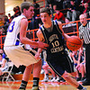 South Central's Rudy Hablewitz drives by Brownstown's Brock Oberlink at the NTC tournament in Altamont.