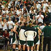 RYAN HUTTON/ Staff photo. The Hornets huddle up just before the start on the game as a sea of fans cheer them on.