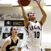 Legacy High School's Emiley Lopez takes a shot in front of Jordan Eisler during a game against Monarch High School on Friday, Jan. 11, at Legacy High School in Broomfield. For more photos of the game go to www.dailycamera.com Jeremy Papasso/ Camera