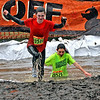 Muck Fest event goers, going through the obstacle course for the annual MS fundraiser, here cousins Alexa Pike,14 of Needham, and Samantha Peters,13, of Sudbury, head out of the Muck-Off pool and into another field of mud.  SUN/ David H. Brow