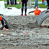 Muck Fest event goers, going through the obstacle course for the annual MS fundraiser, here on the last leg of the course is L-R, Steve Guilmette of Haverhill and Sandy McGee of Portsmouth, RI, they are doing the Belly Crawl.  SUN/ David H. Brow