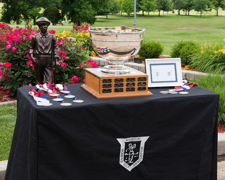 The trophy table with medals and the Junior Trophy.