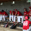 Firelands class E hot stove team waits out the thunderstorm delay. RAY RIEDEL/CHRONICLE