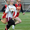 Avon Lake's Molly Maloney moves downfield with ball against Brecksville on Monday night. STEVE MANHEIM/CHRONICLE