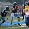 Nightmares quarterback Cody Schuster takes the snap in their first series against the Tigers. CHRISTY LEGEZA/CHRONICLE