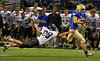 Trojans sophomore wide receiver Trevor Bedard, right, sails past Eastview's Kenny Kirkman on a kick-off return in the first half of Wayzata's 35-21 state tournament quarterfinal defeat of the Lightning Friday, Nov. 9, at the Metrodome in Minneapolis.