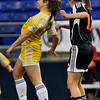 Trojans senior midfielder Kylie Schwarz, left, goes for a header against a White Bear Lake opponent in the first half of Wayzata's 2-0 class 4A state championship win Thursday, Nov. 1, at the Metrodome in Minneapolis.