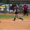 Addison rounds first base after hitting a line drive homerun to center field