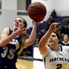 "Boulder High School's Vivi Gregorich tries to block the shot of Austyn Casale, No. 35, during a game against Fort Collins High School on Tuesday, Jan. 29, in Boulder. For more photos of the game go to  <a href=""http://www.dailycamera.com"">http://www.dailycamera.com</a><br /> Jeremy Papasso/ Camera"