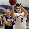 "Boulder High School's Vivi Gregorich takes a shot in front of Nicole Lange during a game against Fort Collins High School on Tuesday, Jan. 29, in Boulder. For more photos of the game go to  <a href=""http://www.dailycamera.com"">http://www.dailycamera.com</a><br /> Jeremy Papasso/ Camera"