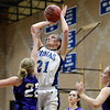 """Peak to Peak's Annette Warner takes a shot over Haley Loptien during a game against Lutheran High School on Wednesday, Jan. 30, at Peak to Peak Charter School in Lafayette. For more photos of the game go to  <a href=""""http://www.dailycamera.com"""">http://www.dailycamera.com</a><br /> Jeremy Papasso/ Camera"""