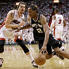 Miami Heat shooting guard Mike Miller (13) looks on as San Antonio Spurs small forward Kawhi Leonard (2) moves the ball during the second half of Game 6 of the NBA Finals basketball game, Tuesday, June 18, 2013 in Miami. (AP Photo/Lynne Sladky)