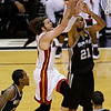 Miami Heat shooting guard Mike Miller (13) drives to the basket against San Antonio Spurs power forward Tim Duncan (21) during the second half of Game 6 of the NBA Finals basketball game, Tuesday, June 18, 2013 in Miami. (AP Photo/Wilfredo Lee)