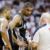 San Antonio Spurs power forward Tim Duncan (21) and San Antonio Spurs point guard Gary Neal (14) listen to official Joe Crawford (17) during the second half of Game 6 of the NBA Finals basketball game against the Miami Heat, Tuesday, June 18, 2013 in Miami. (AP Photo/Lynne Sladky)