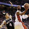 Miami Heat shooting guard Dwyane Wade (3) shoots against San Antonio Spurs shooting guard Danny Green (4) during the second half of Game 6 of the NBA Finals basketball game, Tuesday, June 18, 2013 in Miami. (AP Photo/Lynne Sladky)