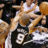Miami Heat point guard Mario Chalmers (15) defends against San Antonio Spurs point guard Tony Parker (9) during the second half of Game 6 of the NBA Finals basketball game, Tuesday, June 18, 2013 in Miami. (AP Photo/Wilfredo Lee)