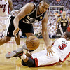 San Antonio Spurs center Boris Diaw (33) of France grabs a ball dropped by Miami Heat shooting guard Dwyane Wade (3) during the second half of Game 6 in the NBA Finals basketball game, Tuesday, June 18, 2013 in Miami. (AP Photo/Lynne Sladky)