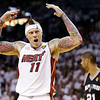 Miami Heat power forward Chris Andersen (11) gets the crowd to cheer against the San Antonio Spurs during the first half in Game 7 of the NBA basketball championship on Thursday, June 20, 2013, in Miami. (AP Photo/Lynne Sladky)
