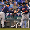 Cleveland Indians' Mike Aviles is congratulated by Brad Mills (2) while rounding third after hitting a home run against the Kansas City Royals in the third inning of their second baseball game, Sunday, April 28, 2013, in Kansas City, Mo. (AP Photo/Reed Hoffmann)