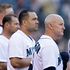 Seattle Mariners bench coach Robby Thompson, right, stands for the national anthem with players before a baseball game against the Cleveland Indians Tuesday, July 23, 2013, in Seattle. Thompson was taking over for manager Eric Wedge, who remained hospitalized after suffering dizziness before Monday's game. (AP Photo/Elaine Thompson)