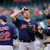 Cleveland Indians starting pitcher Zach McAllister, center, talks with catcher Yan Gomes, right, and Jason Kipnis between Seattle Mariners batters in the first inning of a baseball game Tuesday, July 23, 2013, in Seattle. (AP Photo/Elaine Thompson)