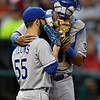 Kansas City Royals catcher Salvador Perez talks to relief pitcher Tim Collins (55) in the sixth inning of a baseball game against the Cleveland Indians Wednesday, June 19, 2013, in Cleveland. (AP Photo/Mark Duncan)