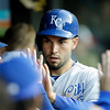 Kansas City Royals' Eric Hosmer is congratulated in the dugout after scoring on a single by David Lough in the fifth inning of a baseball game against the Cleveland Indians Wednesday, June 19, 2013, in Cleveland. (AP Photo/Mark Duncan)