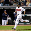 Cleveland Indians' Michael Bourn raced home to score on a sacrifice fly by Mike Aviles in the seventh inning of a baseball game against the Kansas City Royals Wednesday, June 19, 2013, in Cleveland. The Indians won 6-3. (AP Photo/Mark Duncan)