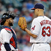 Cleveland Indians catcher Carlos Santana confers with starting pitcher Justin Masterson in the fourth inning of a  baseball game Wednesday, June 19, 2013, in Cleveland. (AP Photo/Mark Duncan)