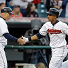 Cleveland Indians' Michael Brantley, right, is congratulated by third base coach Brad Mills after hitting a solo home run off Kansas City Royals starting pitcher Luis Mendoza in the fifth inning of a baseball game on Wednesday, June 19, 2013, in Cleveland. (AP Photo/Mark Duncan)