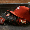 A Philadelphia Phillies hat and glove rest on a step leading into the dugout in a baseball game between the Phillies and the Cleveland Indians, Wednesday, May 1, 2013, in Cleveland. (AP Photo/Tony Dejak)