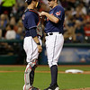 Cleveland Indians' Yan Gomes, left, talks with relief pitcher Bryan Shaw in the sixth inning of a baseball game against the Philadelphia Phillies, Wednesday, May 1, 2013, in Cleveland. (AP Photo/Tony Dejak)