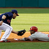 Cleveland Indians' Jason Kipnis, left, tags out Philadelphia Phillies' Jimmy Rollins at second base in the first inning of a baseball game on Wednesday, May 1, 2013, in Cleveland. Rollinswas trying to steal the base. (AP Photo/Tony Dejak)