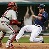 Cleveland Indians' Jason Kipnis, right, slides safely into home plate as Philadelphia Phillies catcher Carlos Ruiz waits for the ball in the third inning of a baseball game on Wednesday, May 1, 2013, in Cleveland. Kipnis scored on a two-RBI double by Asdrubal Cabrera.  Indians' Michael Brantley also scored. (AP Photo/Tony Dejak)