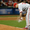 Philadelphia Phillies starting pitcher Cliff Lee works the rosin bag in the sixth inning of a baseball game against the Cleveland Indians, Wednesday, May 1, 2013, in Cleveland. (AP Photo/Tony Dejak)