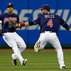 Cleveland Indians' Mike Aviles, right, and Michael Brantley run after a ball hit by Philadelphia Phillies' Domonic Brown in the sixth inning of a baseball game on Wednesday, May 1, 2013, in Cleveland. Brown was safe at first base. (AP Photo/Tony Dejak)