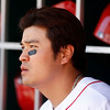 Cincinnati Reds center fielder Shin-Soo Choo watches from the dugout during a baseball game against the Cleveland Indians, Monday, May 27, 2013, in Cincinnati. (AP Photo/David Kohl)