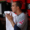 Cleveland Indians starting pitcher Ubaldo Jimenez wipes his face in the dugout during a baseball game against the Cincinnati Reds, Monday, May 27, 2013, in Cincinnati. (AP Photo/David Kohl)