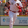 Cincinnati Reds' Joey Votto rounds the bases after hitting a two-run home off Cleveland Indians relief pitcher Nick Hagadone in the eighth inning during a baseball game, Monday, May 27, 2013, in Cincinnati. (AP Photo/David Kohl)