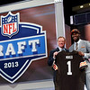 Barkevious Mingo, from Louisiana State, stands with NFL Commissioner Roger Goodell after being selected sixth overall by the Cleveland Browns in the first round of the NFL football draft, Thursday, April 25, 2013, at Radio City Music Hall in New York. (AP Photo/Jason DeCrow)