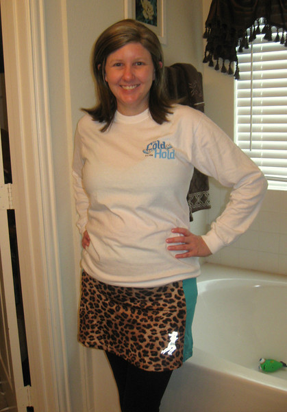 my cheetah pool running skirt, too cold to hold 5k shirt, black running tights, and New Balance 520 running shoes