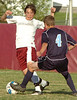 #15 for Dobyns Bennett tries to move the ball past #4 of Sullivan South. Photo by Ned Jilton II