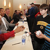 From left, former and 2013 Red Sox Minor League Offensive Player of the Year Spinner Mookie Betts, retired Red Sox player Dave Roberts who stole second and scored the tying run in the 9th inning of Game 4 of the 2004 ALCS against the Yankees, and former Spinner Ryan Westmoreland, sign autographs at the annual Lowell Spinners Hot Stove Dinner. At right is Dylan Carr, 9, with his brother Billy Carr, 11, second from right, of Nashua.(SUN/Julia Malakie)