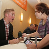 Former Spinner Ryan Westmoreland, talks with Terri Allum of Allenstown, N.H., as he signs autographs at the annual Lowell Spinners Hot Stove Dinner. (SUN/Julia Malakie)