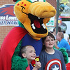 Lowell Spinners vs Williamsport Crosscutters baseball. Adam, 9, and brother Peter McCallion, 11, of Lexington, pose for a photo with the Canaligator on superhero night at LeLacheur Park. (SUN/Julia Malakie)