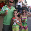 Lowell Spinners vs Williamsport Crosscutters baseball. Rene Lavallee of Lawrence with daughters Caroline, center, and Charlotte, right, both 8 and twins, enjoy ice cream and rainbow ice. (SUN/Julia Malakie)