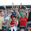 Lowell Spinners vs Williamsport Crosscutters baseball. Fans wave hoping to get catapulted tee shirts. (SUN/Julia Malakie)